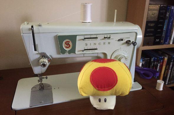 Mario mega-mushroom in front of Singer sewing machine