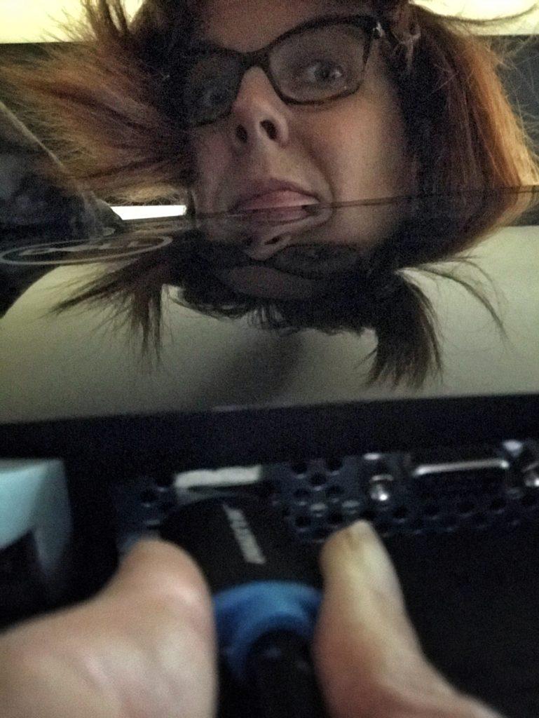 Behind-the-monitor selfie